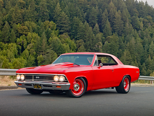 AUT 22 RK3081 01 © Kimball Stock 1966 Chevrolet Chevelle Red 3/4 Front View On Pavement By Hill And Trees