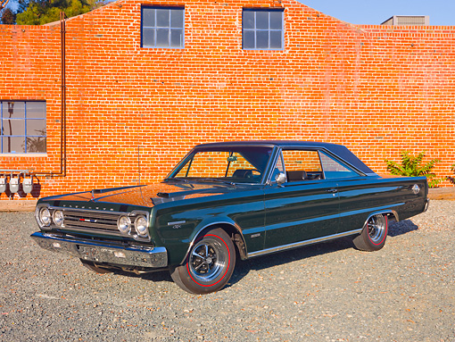 AUT 22 RK3086 01 © Kimball Stock 1967 Plymouth Hemi GTX Dark Green 3/4 Front View On Gravel By Brick Building