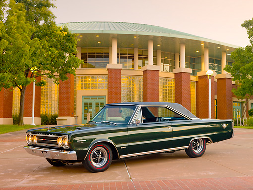 AUT 22 RK3090 01 © Kimball Stock 1967 Plymouth Hemi GTX Dark Green 3/4 Front View On Pavement By Brick Building