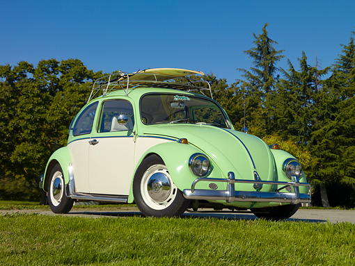 AUT 22 RK3106 01 © Kimball Stock 1967 Volkswagen Bug Green And White 3/4 Front View On Pavement By Grass And Trees