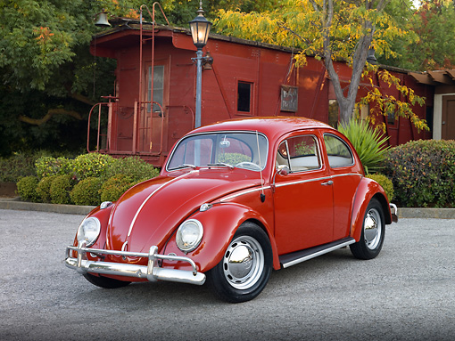 AUT 22 RK3118 01 © Kimball Stock 1964 Volkswagen Beetle Red 3/4 Front View On Pavement By Red Train