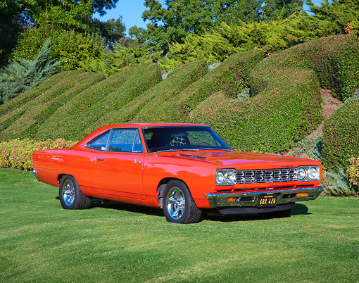 AUT 22 RK3127 01 © Kimball Stock 1968 Plymouth Hemi Road Runner Orange 3/4 Front View On Grass