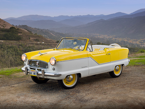 AUT 22 RK3165 01 © Kimball Stock 1960 Nash Metropolitan Yellow And White 3/4 Front View On Gravel By Hills