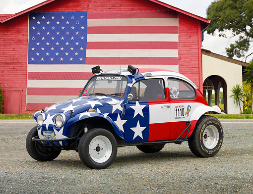 AUT 22 RK3200 01 © Kimball Stock 1967 Volkswagen Baja American Flag 3/4 Side View On Gravel By Barn With American Flag