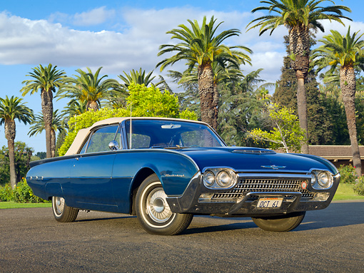 AUT 22 RK3207 01 © Kimball Stock 1962 Ford Thunderbird Dark Blue 3/4 Front View On Pavement By Palm Trees