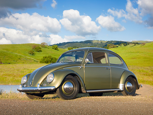 AUT 22 RK3212 01 © Kimball Stock 1963 Volkswagen Beetle Green 3/4 Front View On Dirt By Water And Grassy Hills