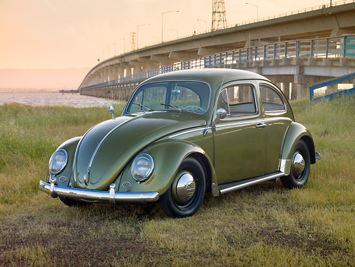 AUT 22 RK3216 01 © Kimball Stock 1963 Volkswagen Beetle Green 3/4 Front View On Grass By Water And Bridge