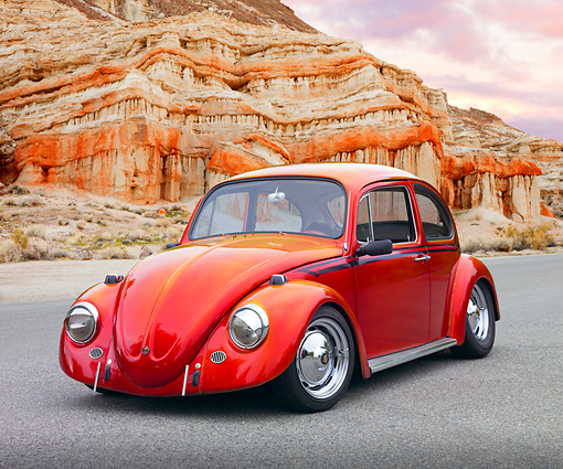 AUT 22 RK3222 01 © Kimball Stock 1967 VW Bug Candy Apple Red 3/4 Front View On Pavement By Red Rock