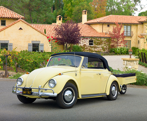 AUT 22 RK3225 01 © Kimball Stock 1967 VW Beetle Convertible Yukon Yellow With Trailer 3/4 Front View On Pavement By House