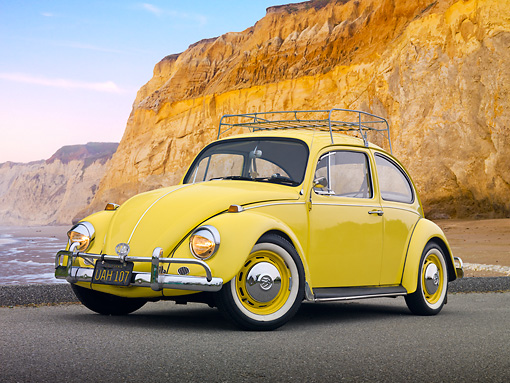 AUT 22 RK3226 01 © Kimball Stock 1967 VW Beetle Yellow 3/4 Front View On Pavement By Beach And Cliffs