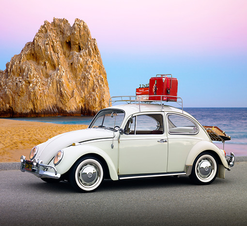 AUT 22 RK3230 01 © Kimball Stock 1966 VW Bug Type I White With Coca-Cola Cooler 3/4 Side View On Pavement By Beach And Rock