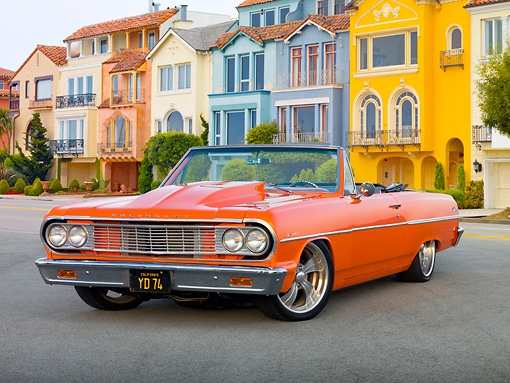 AUT 22 RK3254 01 © Kimball Stock 1964 Chevrolet Chevelle Orange 3/4 Front View On Pavement By Colorful Houses