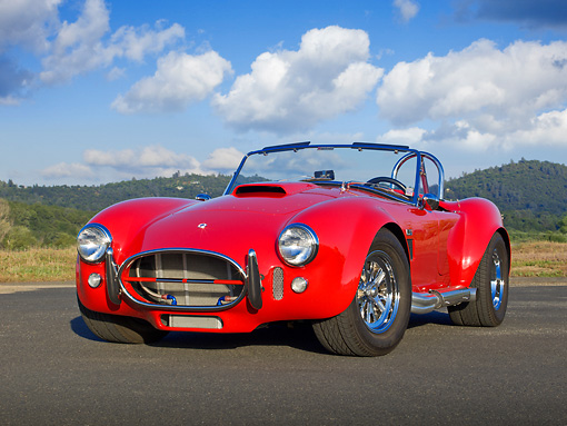 AUT 22 RK3285 01 © Kimball Stock 1965 AC Shelby Cobra MK3 Roadster Red (Monza) 3/4 Front View On Pavement By Trees