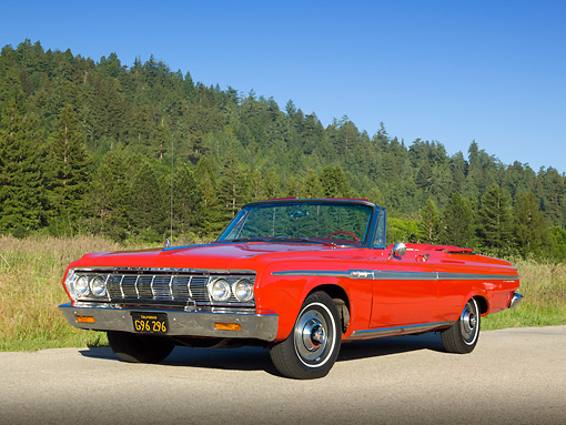 AUT 22 RK3289 01 © Kimball Stock 1964 Plymouth Sport Fury Convertible Red 3/4 Front View On Road By Evergreen Trees