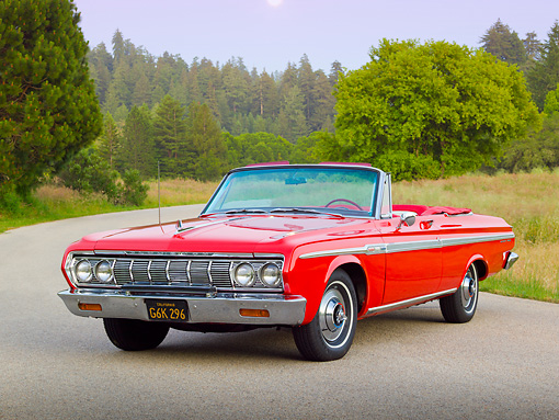 AUT 22 RK3290 01 © Kimball Stock 1964 Plymouth Sport Fury Convertible Red 3/4 Front View On Road By Evergreen Trees