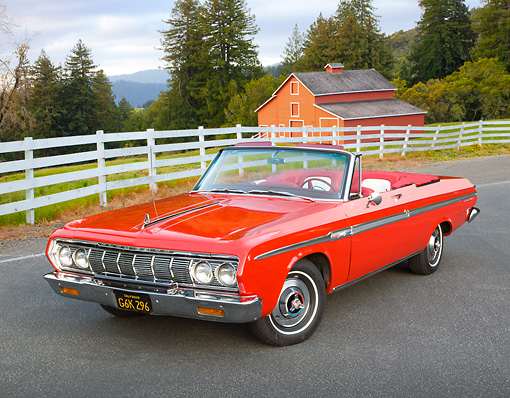 AUT 22 RK3292 01 © Kimball Stock 1964 Plymouth Sport Fury Convertible Red 3/4 Front View On Pavement By Fence And Barn