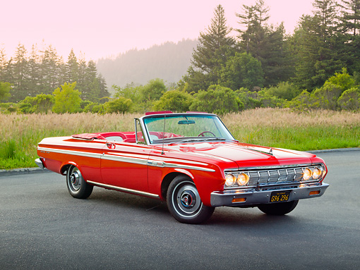 AUT 22 RK3294 01 © Kimball Stock 1964 Plymouth Sport Fury Convertible Red 3/4 Front View On Pavement By Evergreen Trees