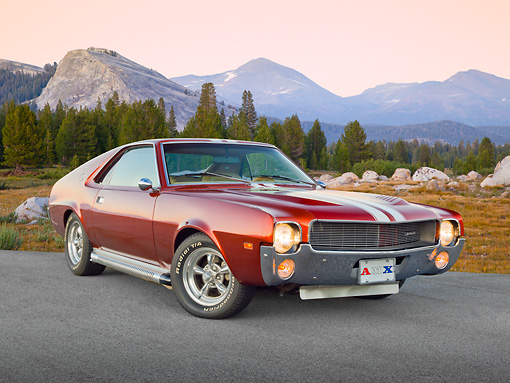 AUT 22 RK3300 01 © Kimball Stock 1969 AMC AMX Candy Tangerine With White Stripes 3/4 Front View On Pavement By Mountains