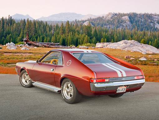 AUT 22 RK3309 01 © Kimball Stock 1969 AMC AMX Candy Tangerine With White Stripes 3/4 Rear View On Pavement By Mountains
