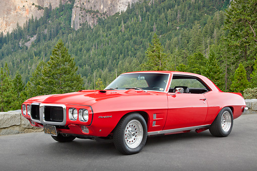 AUT 22 RK3313 01 © Kimball Stock 1969 Pontiac Firebird Red 3/4 Front View On Pavement By Pine Trees