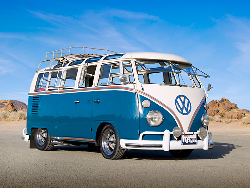 AUT 22 RK3318 01 © Kimball Stock 1965 Volkswagen Deluxe Microbus Blue And White 3/4 Front View On Pavement By Sand And Rocks