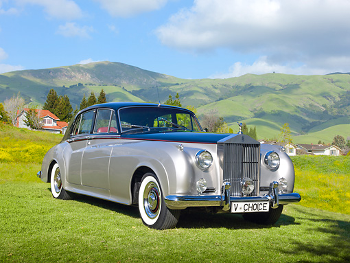 AUT 22 RK3328 01 © Kimball Stock 1960 Rolls-Royce Silver Cloud II Radford Countryman Black And Silver 3/4 Front View On Grass By Hills