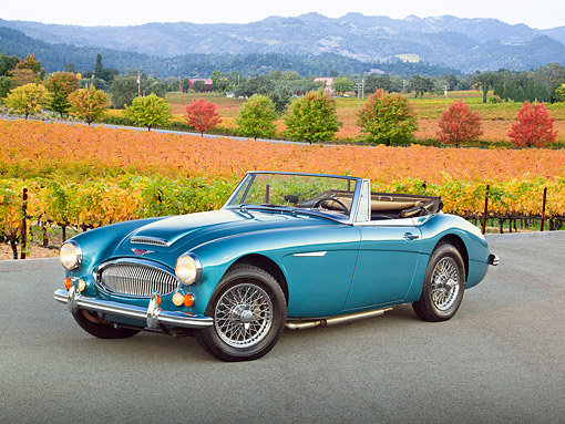 AUT 22 RK3338 01 © Kimball Stock 1966 Austin-Healey 3000 Mark III Blue 3/4 Front View On Pavement By Vineyard