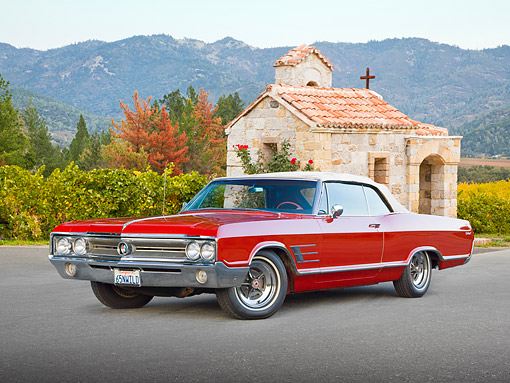 AUT 22 RK3343 01 © Kimball Stock 1965 Buick Wildcat Convertible Red 3/4 Front View On Pavement By Chapel And Trees