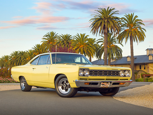 AUT 22 RK3353 01 © Kimball Stock 1968 Plymouth Road Runner Yellow 3/4 Front View On Pavement By Palm Trees
