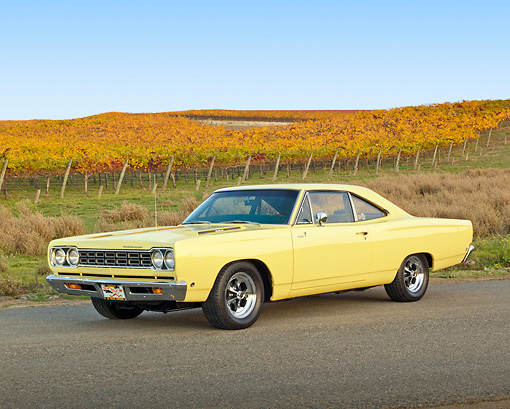 AUT 22 RK3354 01 © Kimball Stock 1968 Plymouth Road Runner Yellow 3/4 Front View On Road By Vineyard
