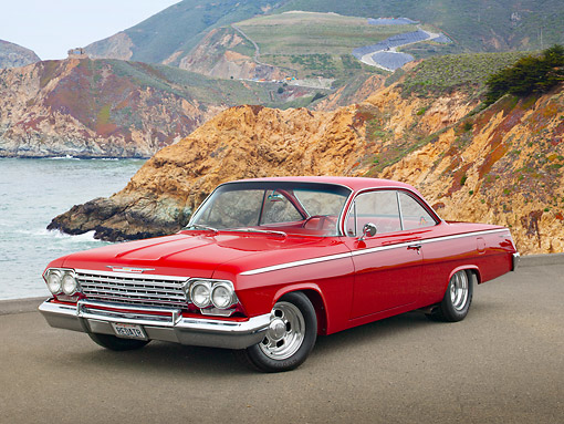 AUT 22 RK3377 01 © Kimball Stock 1962 Chevrolet Bel Air Red 3/4 Front View On Pavement By Coast