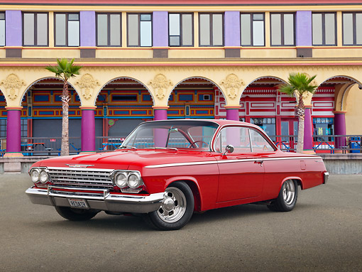 AUT 22 RK3378 01 © Kimball Stock 1962 Chevrolet Bel Air Red 3/4 Front View On Pavement By Boardwalk