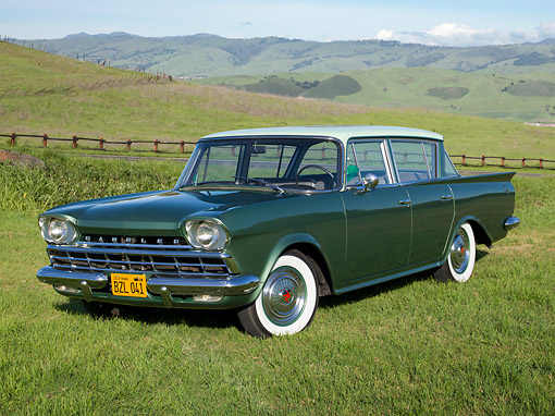 AUT 22 RK3383 01 © Kimball Stock 1960 AMC Rambler Deluxe Green 3/4 Front View On Grass By Road