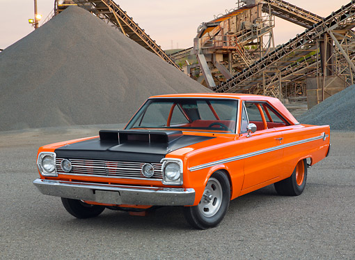 AUT 22 RK3420 01 © Kimball Stock 1966 Plymouth Belvedere II Orange 3/4 Front View On Pavement By Gravel Piles