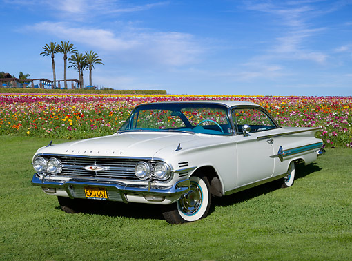 AUT 22 RK3427 01 © Kimball Stock 1960 Chevrolet Impala White 3/4 Front View On Grass  By Field Of Flowers
