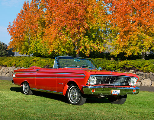 AUT 22 RK3435 01 © Kimball Stock 1964 Ford Falcon Sprint Red 3/4 Front View On Grass By Autumn Trees