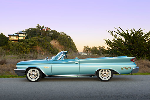 AUT 22 RK3439 01 © Kimball Stock 1960 Chrysler New Yorker Convertible Turquoise Profile View On Pavement By Grass At Dusk