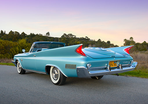 AUT 22 RK3440 01 © Kimball Stock 1960 Chrysler New Yorker Convertible Turquoise 3/4 Rear View On Pavement By Grass At Dusk