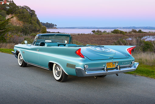 AUT 22 RK3441 01 © Kimball Stock 1960 Chrysler New Yorker Convertible Turquoise 3/4 Rear View On Pavement By Bay At Dusk