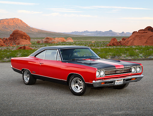 AUT 22 RK3446 01 © Kimball Stock 1969 Plymouth GTX Red With Black Stripes 3/4 Front View On Pavement In Desert