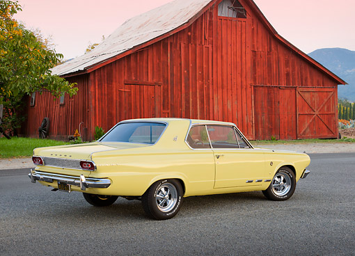 AUT 22 RK3452 01 © Kimball Stock 1965 Dodge Dart Charger Yellow 3/4 Rear View On Pavement By Red Barn