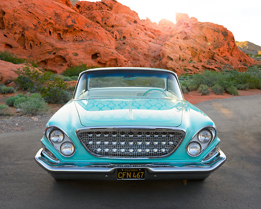 AUT 22 RK3454 01 © Kimball Stock 1962 Chrysler Newport Turquoise Front View On Pavement By Red Rock