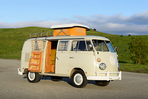 AUT 22 RK3463 01 © Kimball Stock 1966 Volkswagen Camper Cream 3/4 Side View On Pavement By Grassy Hills