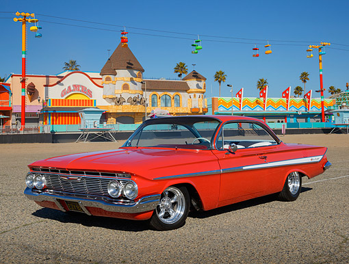 AUT 22 RK3470 01 © Kimball Stock 1961 Chevrolet Impala Red 3/4 Front View On Pavement By Boardwalk