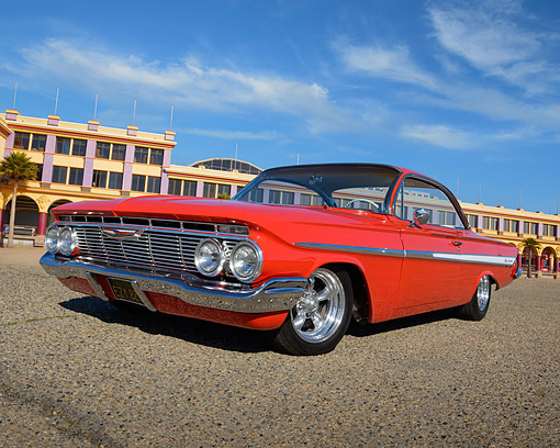 AUT 22 RK3471 01 © Kimball Stock 1961 Chevrolet Impala Red 3/4 Front View On Pavement By Boardwalk