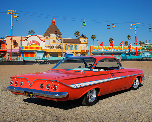 AUT 22 RK3472 01 © Kimball Stock 1961 Chevrolet Impala Red 3/4 Rear View On Pavement By Boardwalk