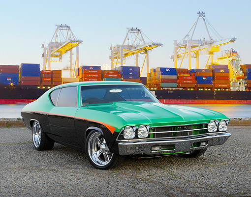 AUT 22 RK3475 01 © Kimball Stock 1969 Chevrolet Chevelle Green, Black And Orange 3/4 Front View On Pavement By Shipping Harbor