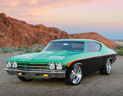 AUT 22 RK3478 01 © Kimball Stock 1969 Chevrolet Chevelle Green, Black And Orange 3/4 Front View On Pavement By Red Rock