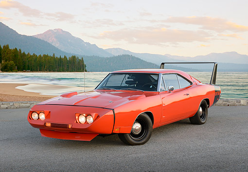 AUT 22 RK3480 01 © Kimball Stock 1969 Dodge Charger Daytona Hemi Orange 3/4 Front View On Gravel By Beach