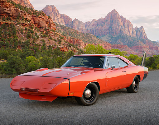 AUT 22 RK3481 01 © Kimball Stock 1969 Dodge Charger Daytona Hemi Orange 3/4 Front View On Gravel By Red Rock